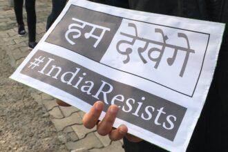 Protest sign at Delhi
